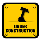Under Construction Sign. With hammer isolated on white background Royalty Free Stock Photo