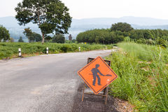 Under construction sign on damage road Stock Photography