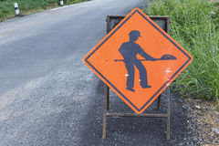 Under construction sign on damage road Royalty Free Stock Images
