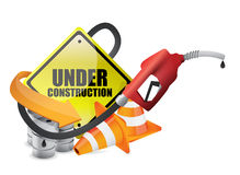 Under construction sign with a gas pump nozzle Stock Images