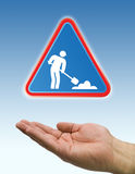 Under construction sign with hand Stock Image