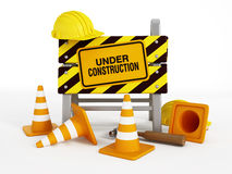 Under construction. Sign, helmets, traffic cones and tools
