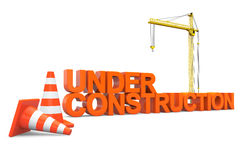 Under construction sign with Hoisting Crane Stock Photo