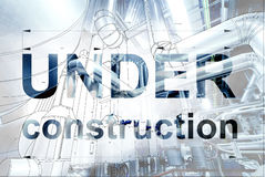 Under construction sign over cad design of pipelines. For modern industrial power plant stock photos