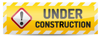 Under construction sign. With reflection and shadow on white background Royalty Free Stock Photo