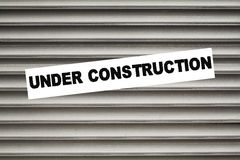 UNDER CONSTRUCTION. Sign on shutter Stock Photography