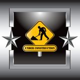 Under construction sign in silver star frame Stock Photo