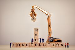 Under Construction sign on wooden tiles. Macro concept.  Royalty Free Stock Photography