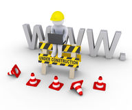 Under construction sign and worker in front of www letters. 3d worker with laptop is sitting on an under construction sign in front of www letters Royalty Free Stock Photos