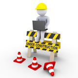 Under construction sign and a worker with laptop. 3d worker with laptop is sitting on an under construction sign Royalty Free Stock Images