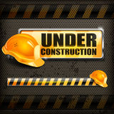 Under construction sign & helmet Stock Images