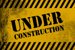 Under construction sign yellow with stripes Stock Images