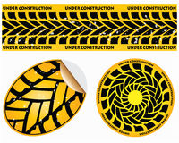 Under construction signs. With tire design Royalty Free Stock Images