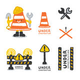 Under construction signs set in cartoon style Royalty Free Stock Image