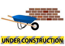 Under construction site with wheelbarrow and wall Royalty Free Stock Images