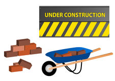 Under construction site with wheelbarrow and wall Royalty Free Stock Image