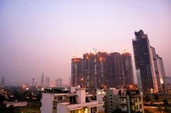 Under construction skyscraper shot at dusk in noida gurgaon. Under construction skyscraper shot at dusk in gurgaon, noida, lucknow, jaipur, mumbai, gurugram NCR stock photography