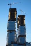 Under construction skyscraper on sunset Stock Photos