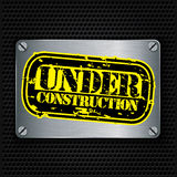 Under construction stamp on metal textured plate, vector Stock Image