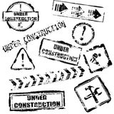 Under construction stamps Royalty Free Stock Photos