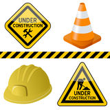 Under Construction Symbols Set. Under construction or work in progress symbols set (signs, traffic cone and hard hat), isolated on white background. Eps file royalty free illustration