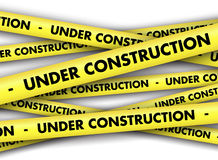 Under construction tape background Stock Photos