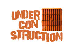 Under construction text and bricks Royalty Free Stock Photo
