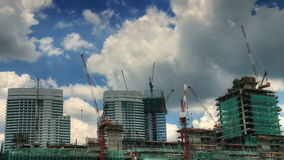 Under construction time lapse. Under construction skyscrapers surrounded by moving cranes and racing clouds time lapse stock video footage