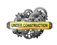 Under construction web page. With gears and pinions for website reconstruction image Stock Image