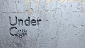 Under Construction word carved in stone wal. L animation stock video