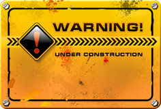 Under Construction, yellow grunge sign vector. Under Construction, yellow grunge warning sign vector with splats Stock Images