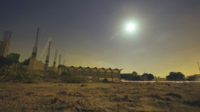 Under constuction building in moonlight. Long exposure gym, Karachi University 05/11/2014 Stock Photos