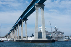 Under the Coronado Bay Bridge and navy ships Stock Photos