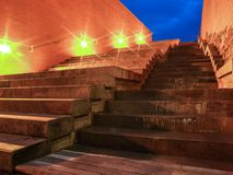 Waterfall fountain embedded in the stairs. Under the dark blue sky the orange lights mark the way through the steps towards Nove sady area in the city Brno royalty free stock photography