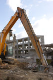 Under destruction. Excavator on a building destruction site Royalty Free Stock Photography