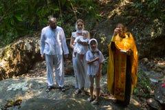 Under dopet - kristen sakrament av andlig födelse Royaltyfria Bilder