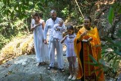 Under dopet - kristen sakrament av andlig födelse Royaltyfri Fotografi