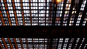 Under the Duluth Aerial Lift Bridge. As traffic drives by overhead stock video footage