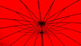 Under dusty red umbrella, background. Stock Images