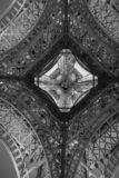 Under Eiffel tower with black and white stock photo