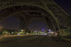 Under the Eiffel Tower without crowds. Very early in the morning, with the Montparnasse Tower in the background Stock Image