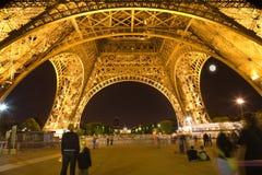Under the Eiffel Tower illuminated at night Stock Photography