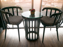 Under exposure of cozy wooden table with the red orchid Royalty Free Stock Photo