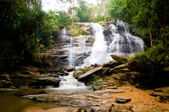 Under the falls. A waterfall not very far from chiang mai stock photo