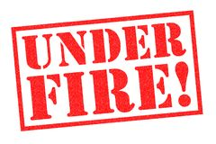 UNDER FIRE! Rubber Stamp. UNDER FIRE! red rubber stamp over a white background Stock Photos