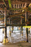 Under a Fishing Pier along the Ocean Stock Photo