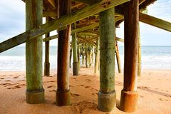 Under the Flagler Beach Pier in Florida stock photography
