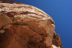 Under a giant rock or boulder Royalty Free Stock Images