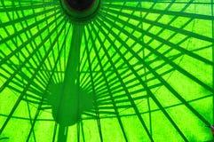 Under green umbrella Stock Photo