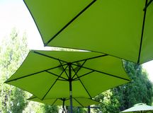 Under the green umbrellas. Under the green patio umbrellas Stock Photo